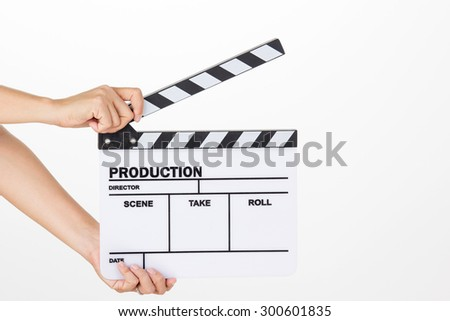 Asian woman holding movie production clapper board on white background - stock photo