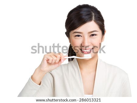 Asian woman holding with toothbrush