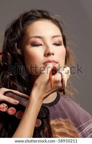Asian woman in a beauty salon. - stock photo
