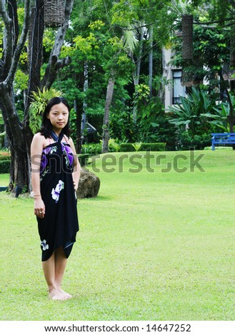 Asian woman in a pretty summer sarong.