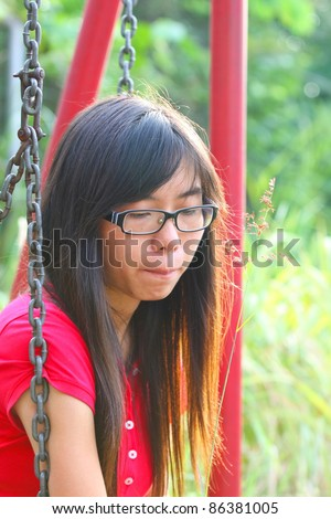 Asian woman in a sad mood - stock photo