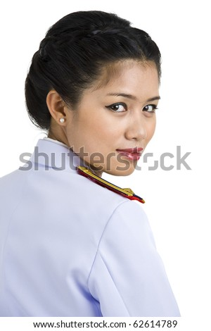 asian woman in army uniform looking back over her shoulder, isolated on white background - stock photo