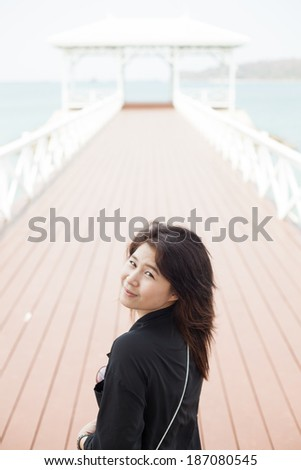 Asian woman in black jacket.  - stock photo