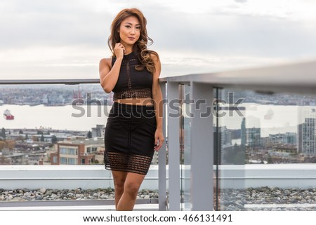 Asian Woman in Black Skirt on Patio