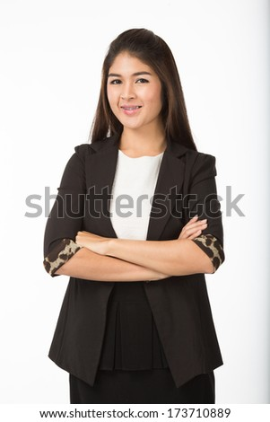 Asian woman in formal casual suit crossing her arms, half body portrait. Isolated on white background.