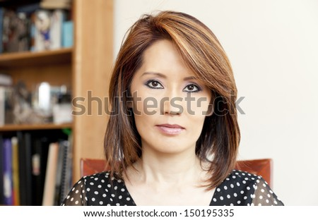 Asian woman in her office - stock photo