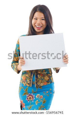 Asian woman in Kebaya holding a white blank card, kebaya usually worn by women in Indonesia, Malaysia, Brunei, Burma, Singapore, southern Thailand. - stock photo