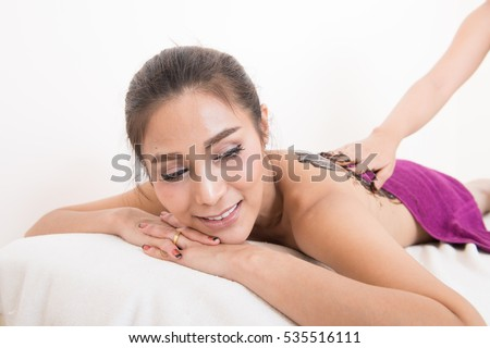 Asian woman in wellness beauty spa having aroma therapy massage with essential oil, Thailand