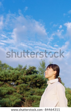 Asian woman in woods - stock photo