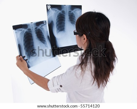 asian woman is analysing the x-ray images - stock photo