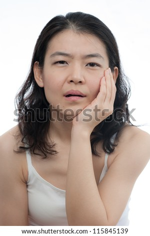Asian woman is having toothache in white background