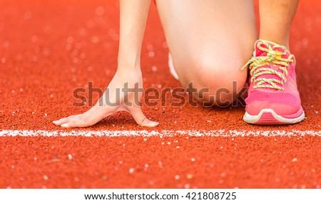 Asian woman is running in running track stadium, Thailand - stock photo