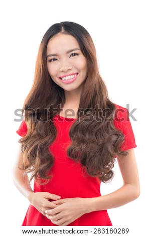 Asian woman isolated on white background. Casual mixed-race Asian Caucasian woman smiling looking happy in light red dress.