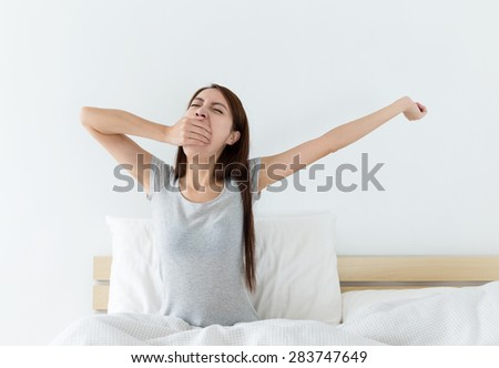 Asian woman just wake up in living room - stock photo