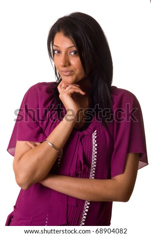 asian woman looking pensive dressed in traditional clothing.