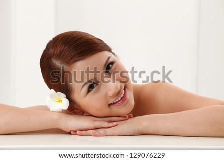 Asian woman lying down on her hand - stock photo