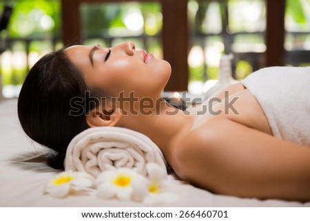 Asian woman lying ready for massage - stock photo
