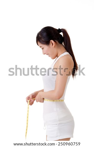 Asian woman measuring herself with measure tape. - stock photo