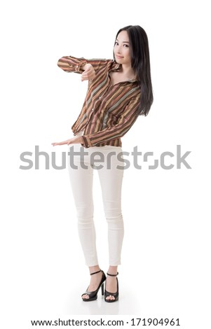 Asian woman of hold something like paper, board by hand, full length portrait isolated on white background. - stock photo