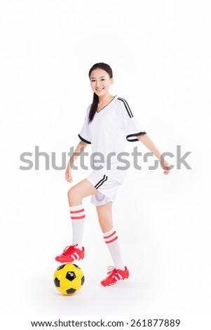 asian woman playing football, white background - stock photo