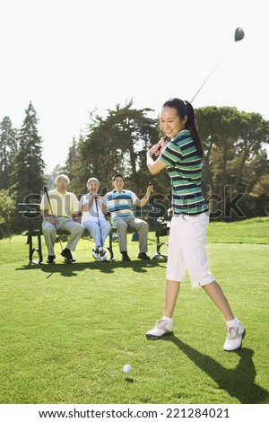 Asian woman playing golf