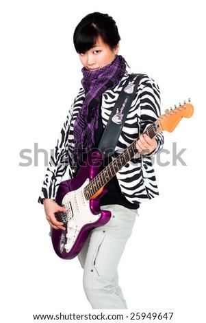 Asian woman playing on purple guitar - stock photo