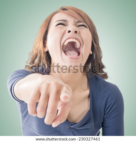 Asian woman pointing and laughing at you, closeup portrait. - stock photo