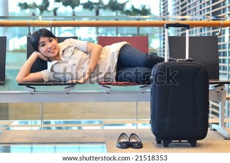 asian woman posing at airport - stock photo