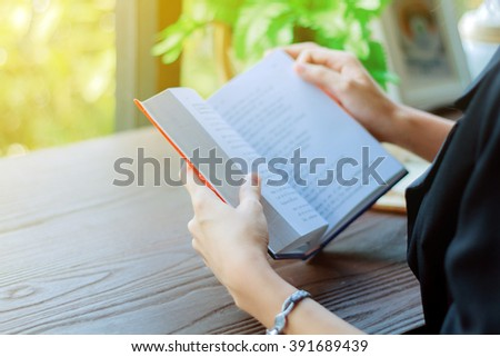 Asian woman reading a book  for relaxation . - stock photo