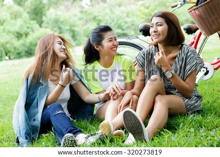 asian woman relaxing in the park for business and vacation