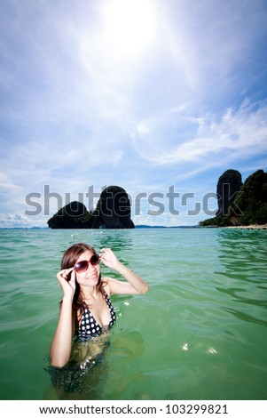 Asian woman relaxing on the sea - stock photo