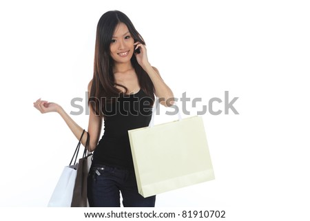 Asian Woman Shopping With Bags Isolated on White