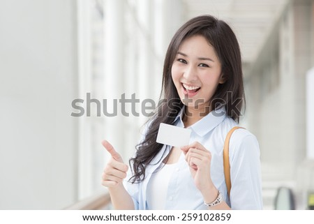 Asian woman shopping with credit card - stock photo