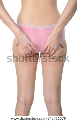 asian woman show her fat and cellulite on buttocks on white background - stock photo