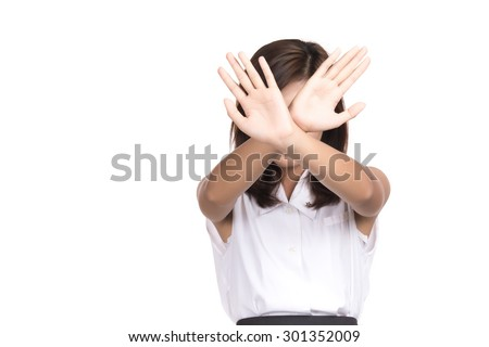 Asian woman showing denial with NO on her hand with blank copy space,Portrait of beautiful Asian woman, Thai girl, Negative human emotion expression, isolated on white background - stock photo
