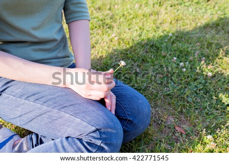 Asian woman sitting on the green field