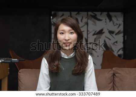asian woman sitting on the sofa
