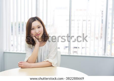 asian woman sitting on the table