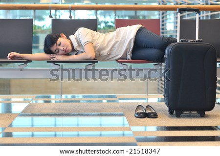 asian woman sleeping at airport