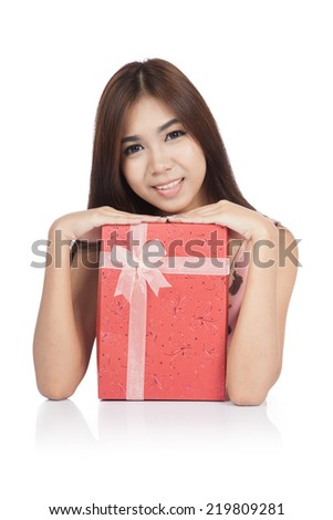 Asian woman smile put her chin on red gift box  isolated on white background - stock photo