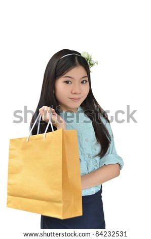 Asian woman smiling and holding shopping bag isolated on white background - stock photo