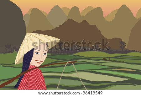 Asian woman smiling while working in rice fields at sunset with mountains behind