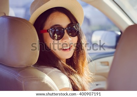 Asian woman smiling with travel by car - lifestyle journey summer outdoor - stock photo