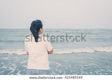 Asian woman standing on the beach, Thailand