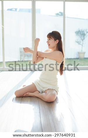 Asian woman stretching in the room - stock photo