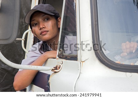 Asian woman truck driver. - stock photo
