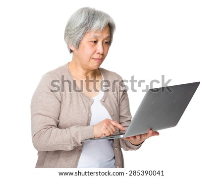 Asian woman use of laptop computer - stock photo