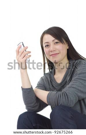 Asian woman using a smart phone - stock photo