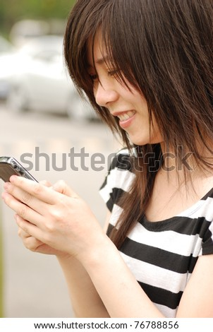 asian woman using cell phone - stock photo