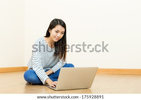 Asian woman using laptop at home